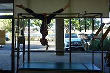 pilates austin hanging splits on the Cadillac